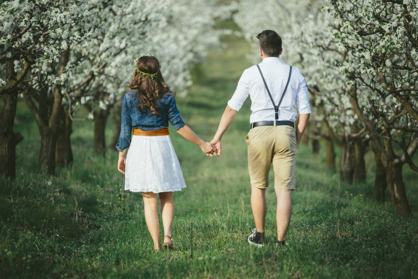 couple walking hand in hand shutterstock
