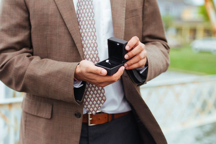man holding a box with an engagement ring