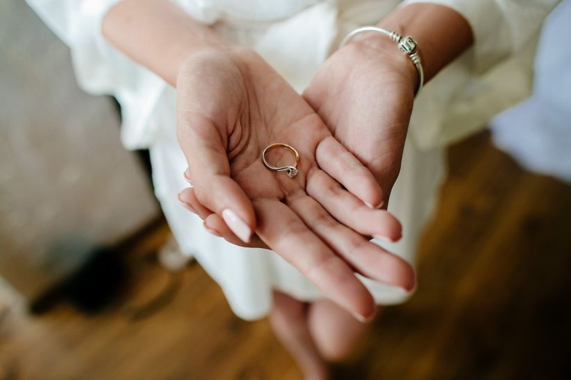 holding engagement ring
