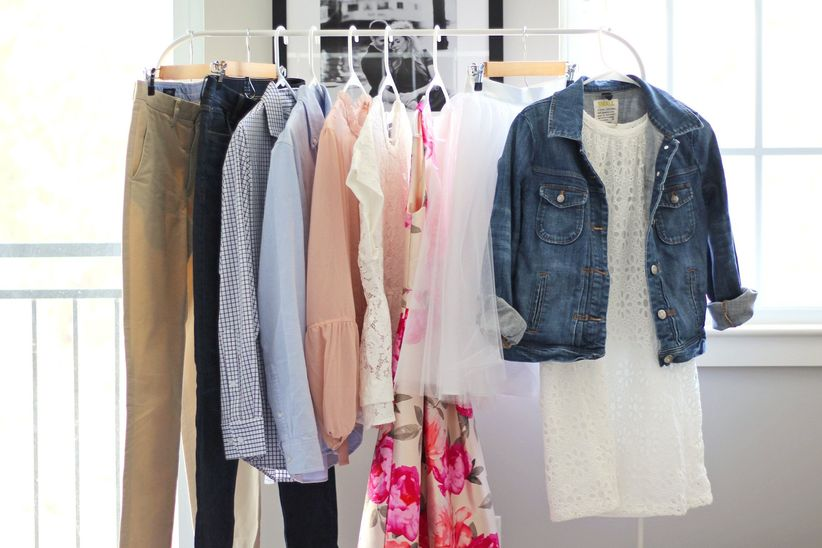 clothes hanging in closet engagement photo outfits