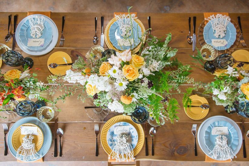 bohemian wedding tablescape with blue and yellow decor