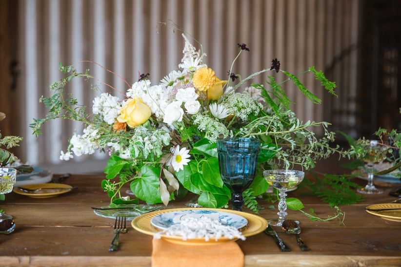 bohemian wedding centerpiece with white and yellow flowers