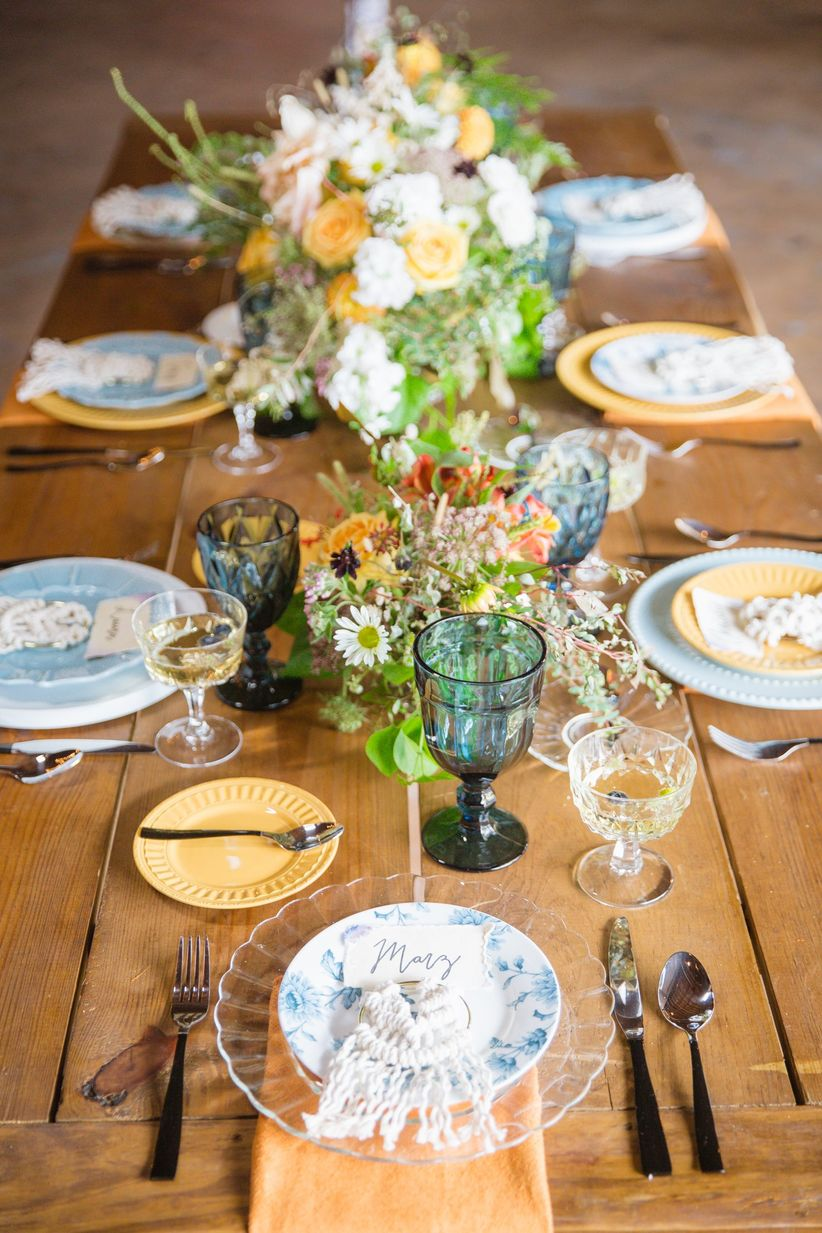 boho wedding tablescape with blue and yellow decor