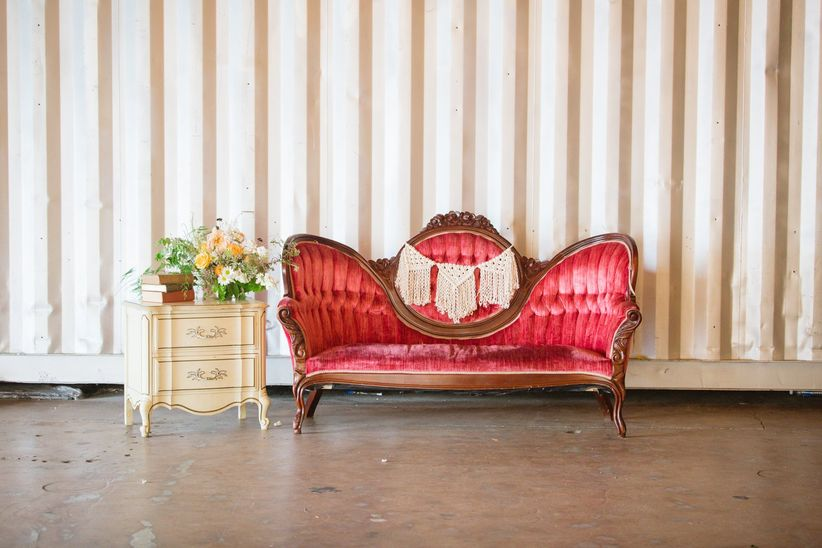 bohemian wedding lounge with vintage velvet couch