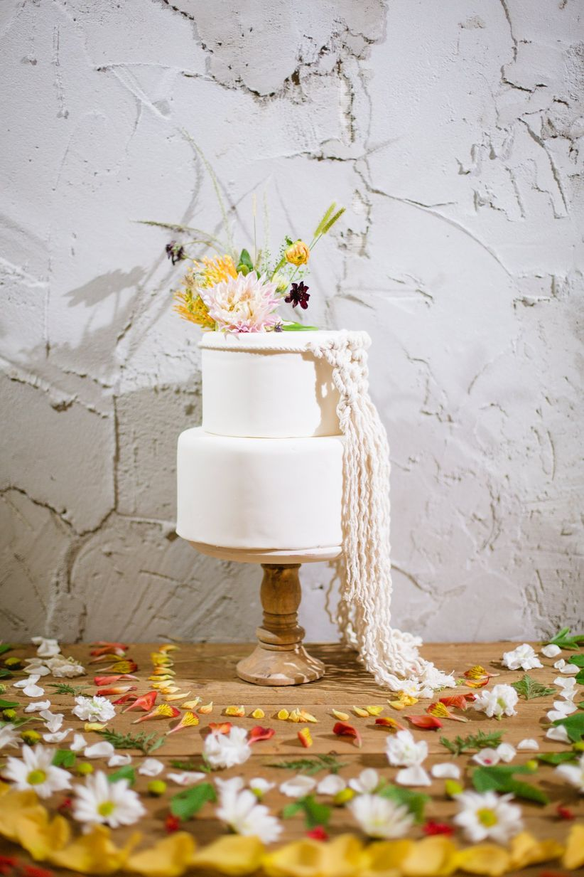 boho wedding cake with macrame and flowers
