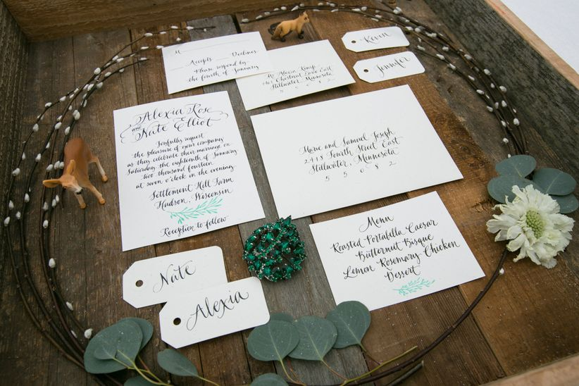 modern invitation suite hand written calligraphy silver dollar eucalyptus woodland figurines