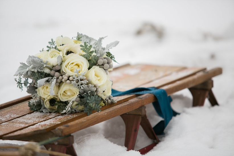 bridal bouquet roses brunia berries dusty miller on sled