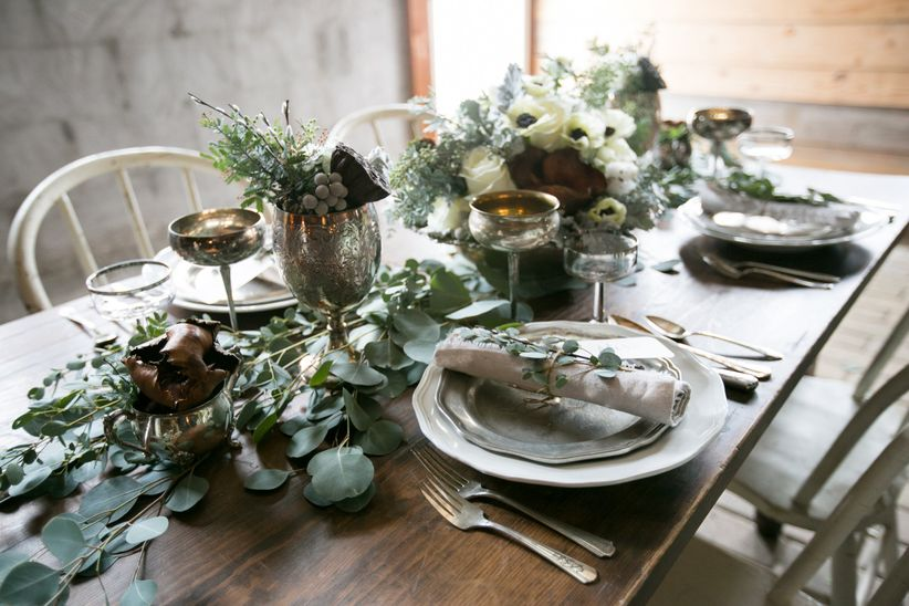 rustic vintage-inspired table scape winter foliage metallic drinkware floral centerpiece