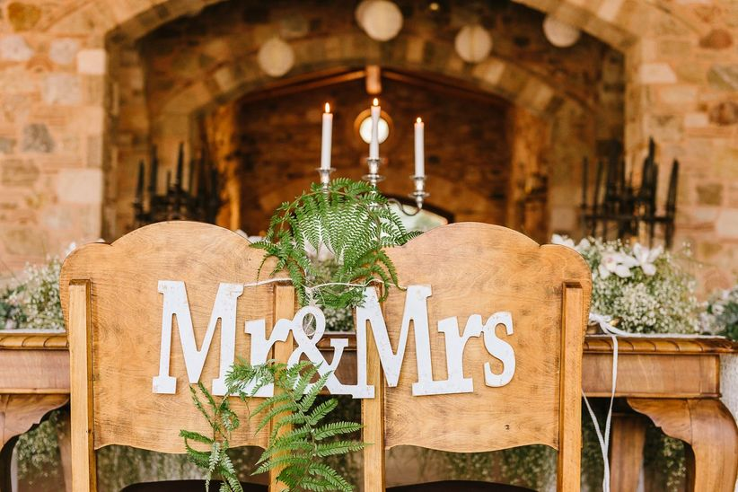 high back chairs rustic mr and mrs wood signs ferns outdoor sweetheart table