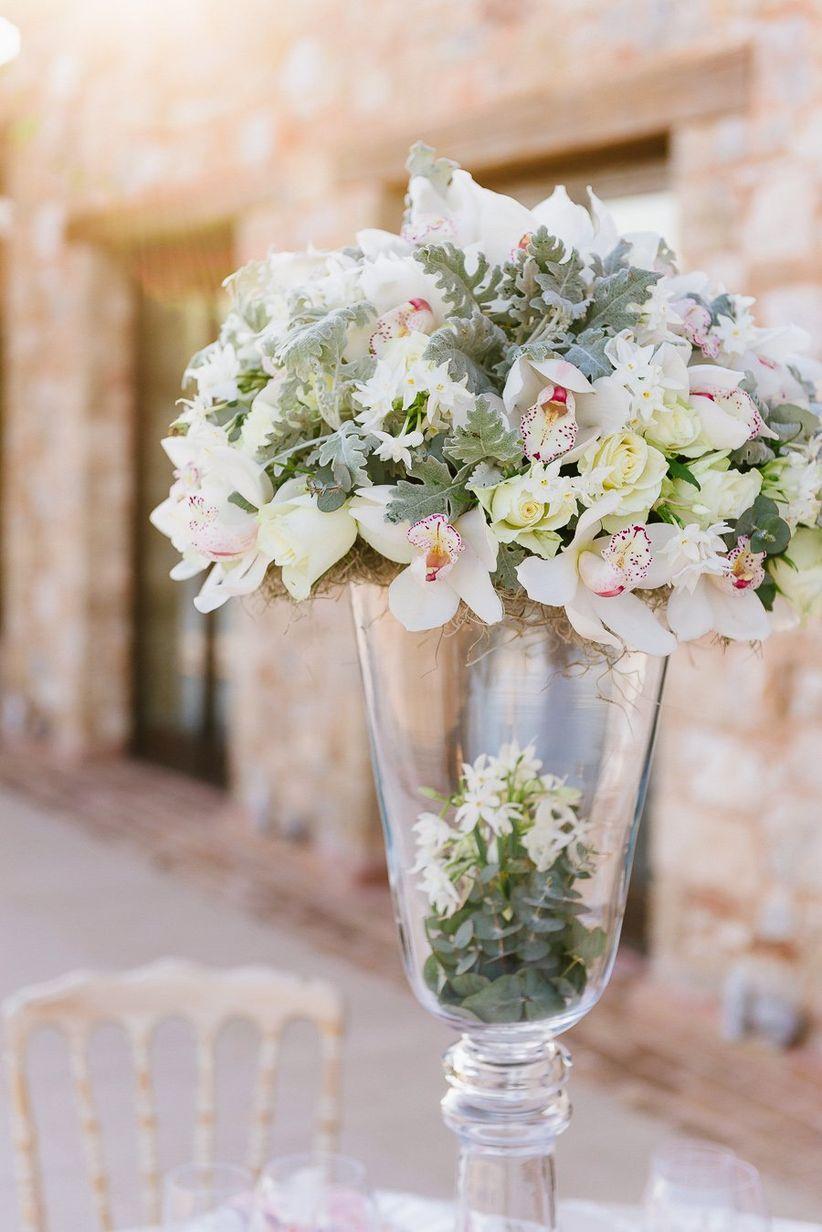 large pedestal vase orchids roses dusty miller elegant shabby chic tablescape