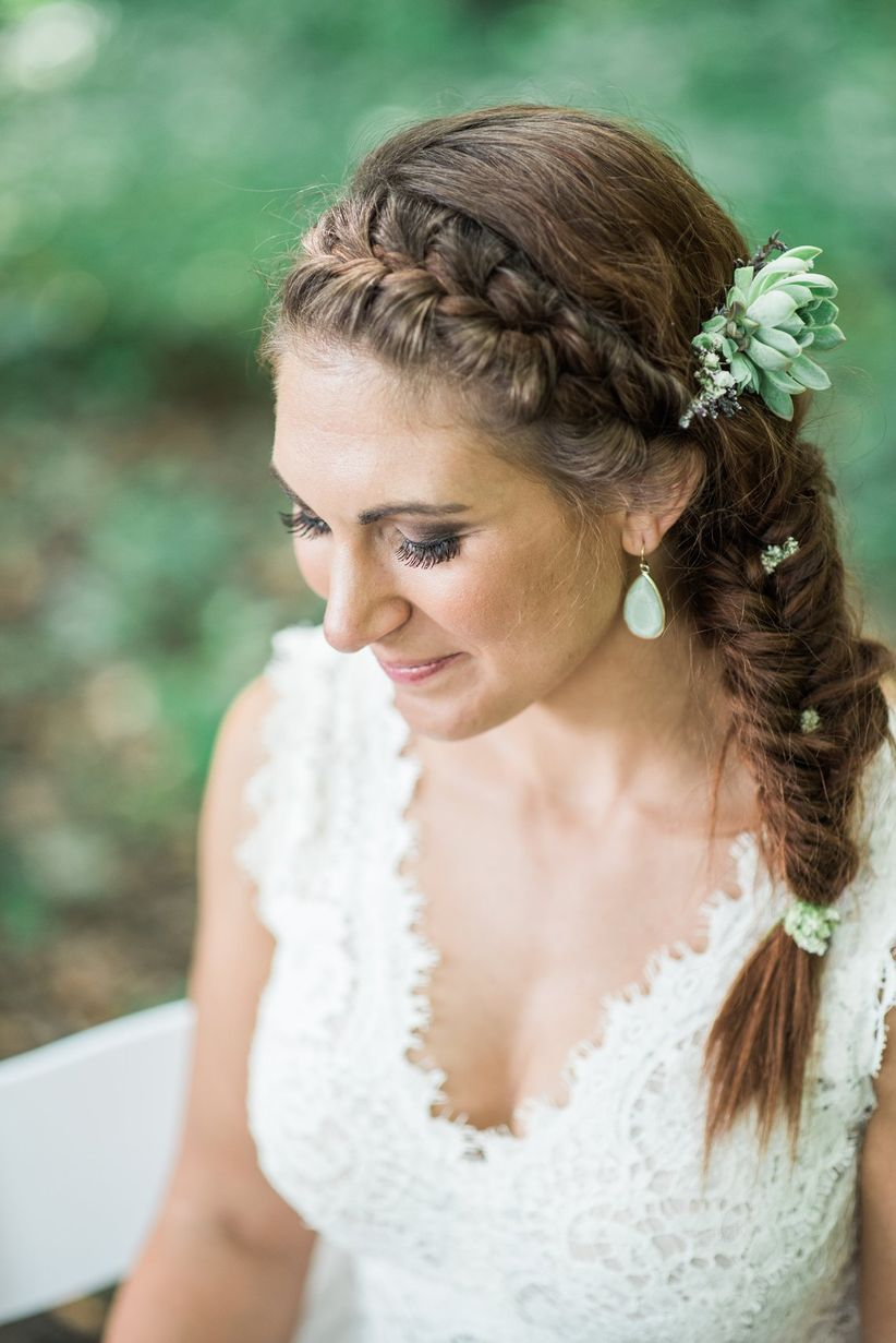 bride with fishtail braid sitting outside for portrait