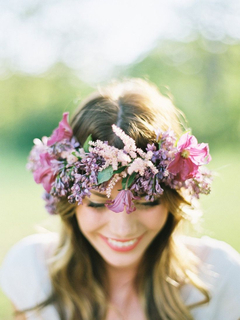 bride wearing purple flower crown