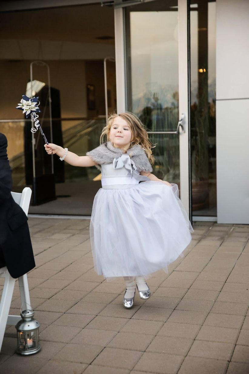 flower girl carrying wand
