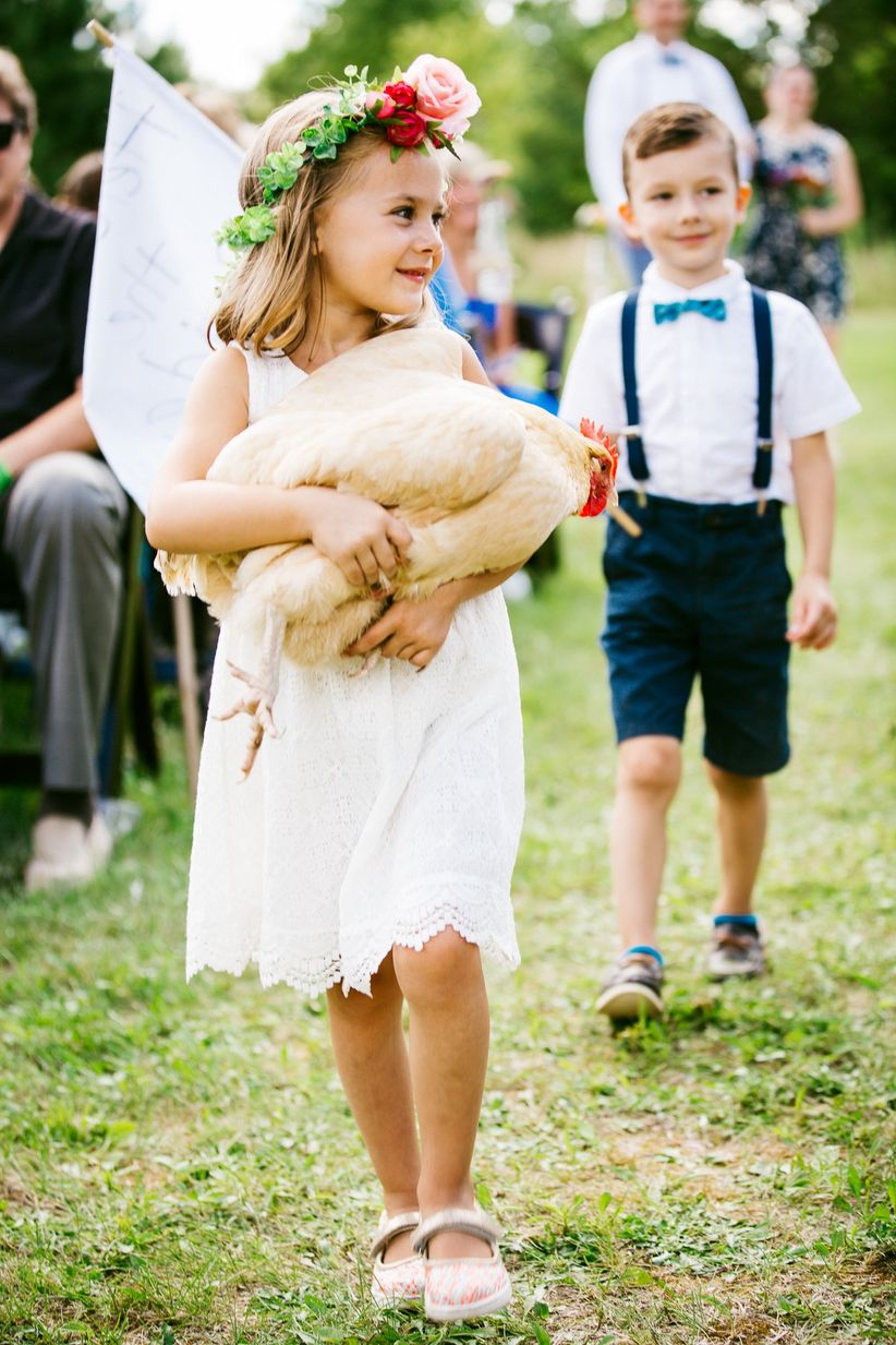 flower girl carrying a chicken