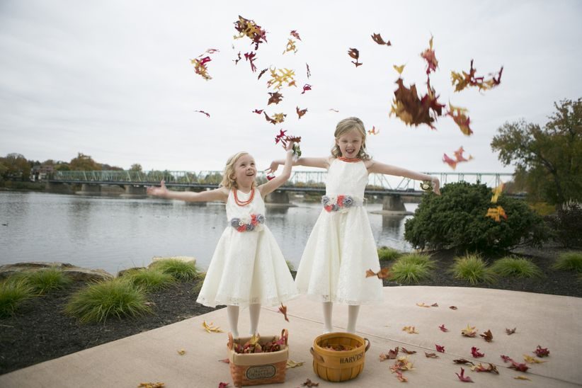 flower girls with fall leaves