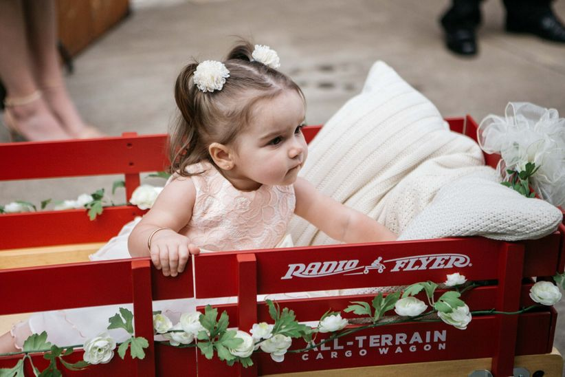 flower girl in wagon