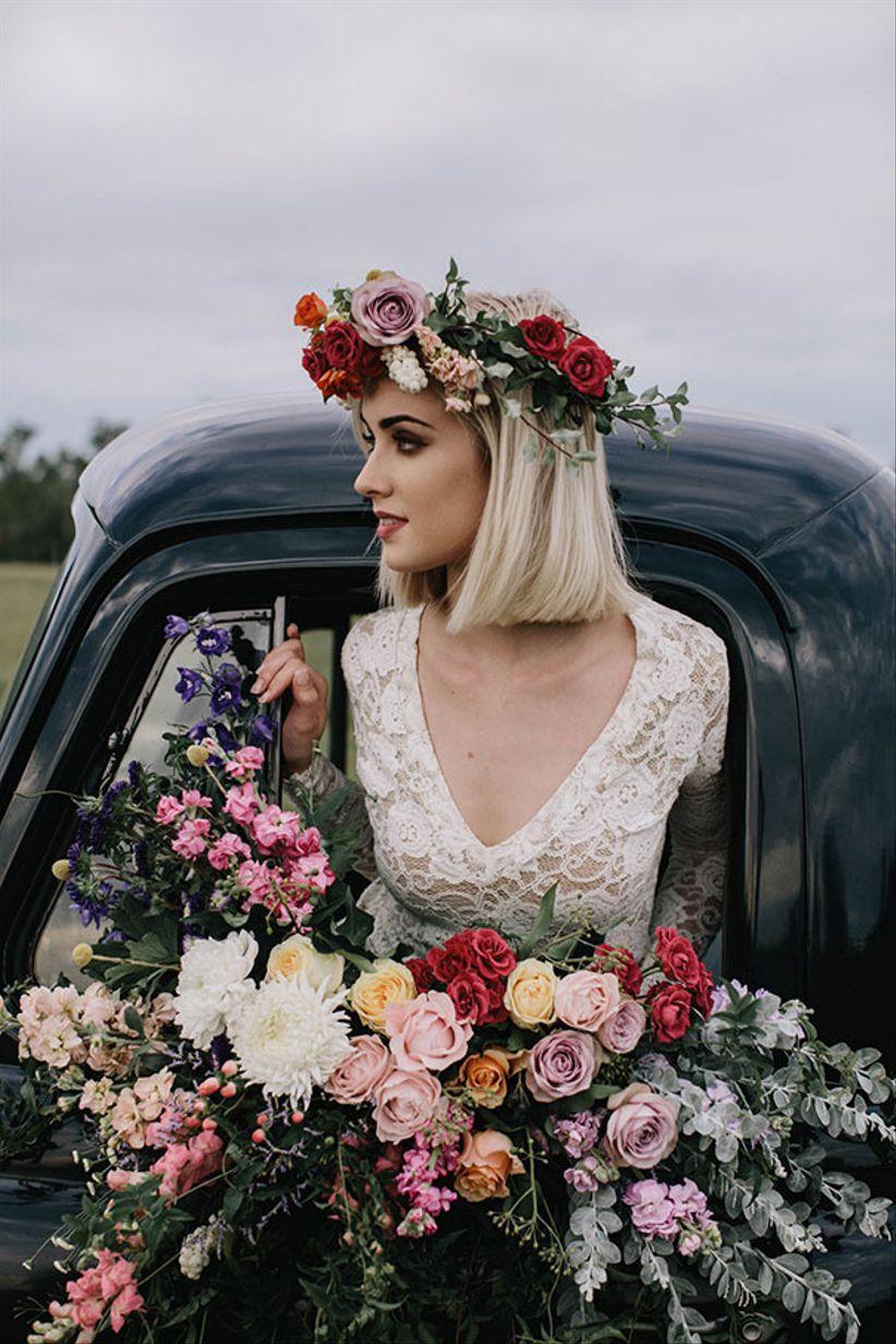 bride wearing colorful flower crown