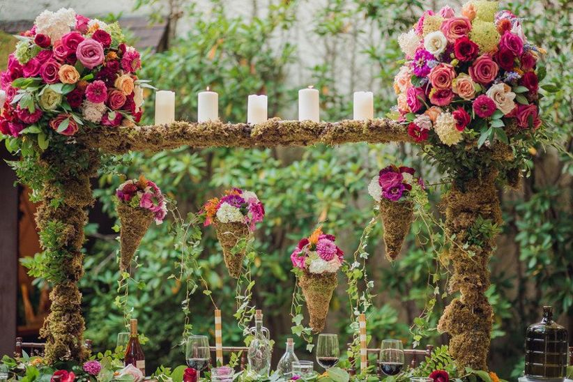 romantic garden wedding tablescape idea with moss and floral centerpiece
