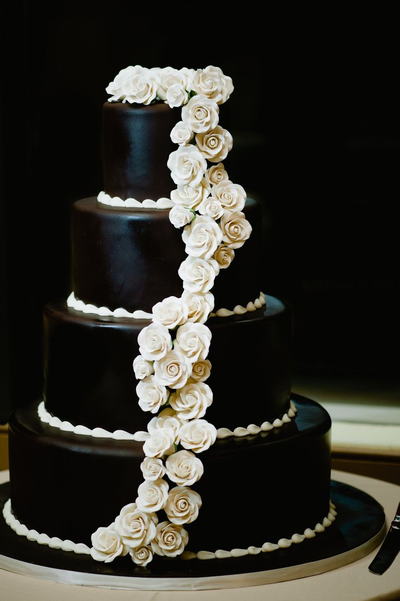 black fondant wedding cake decorated with white sugar flowers