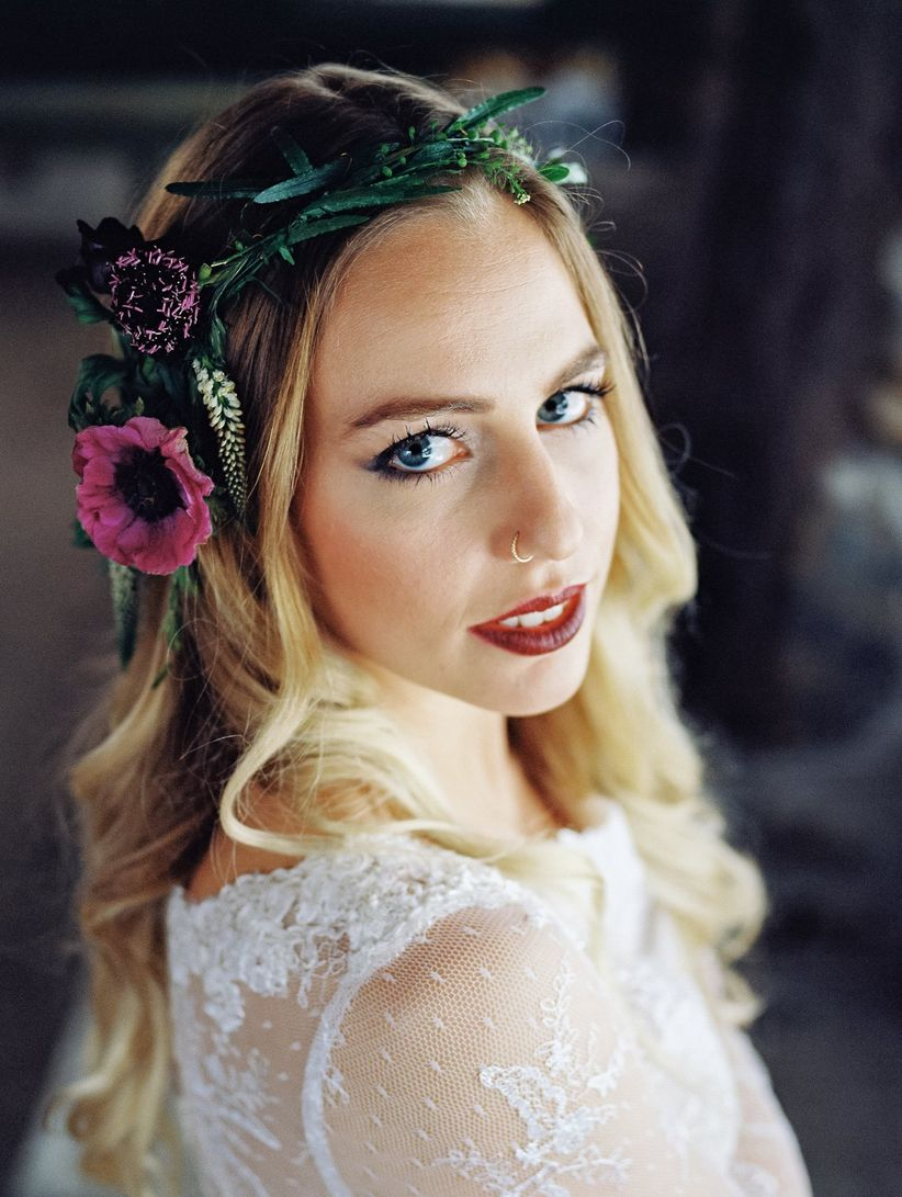 bride with blonde ombre hair in loose waves with flower crown gold nose ring burgundy lip