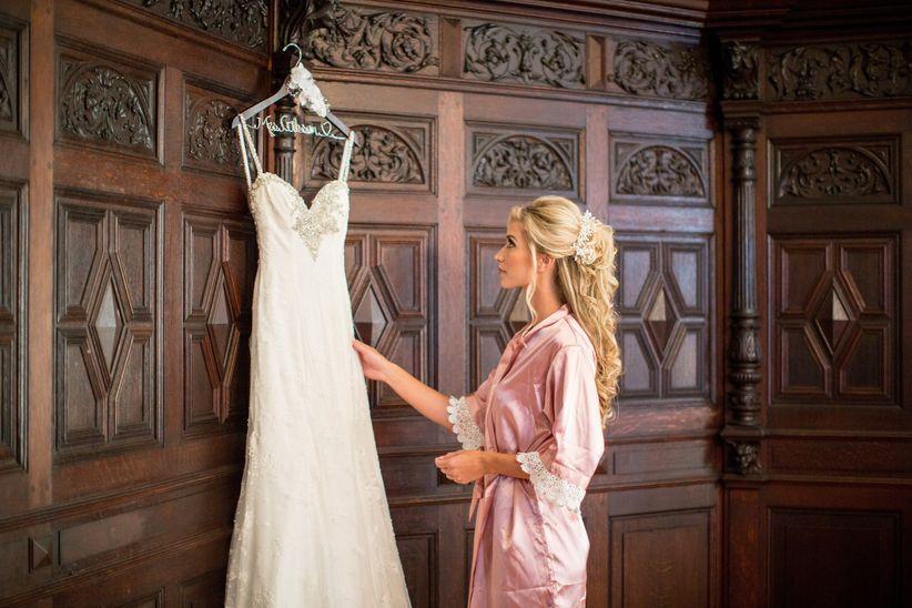 bride looking at wedding dress