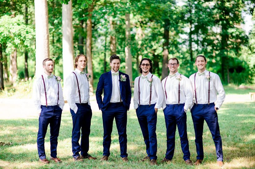 groomsmen wearing suspenders and blue pants