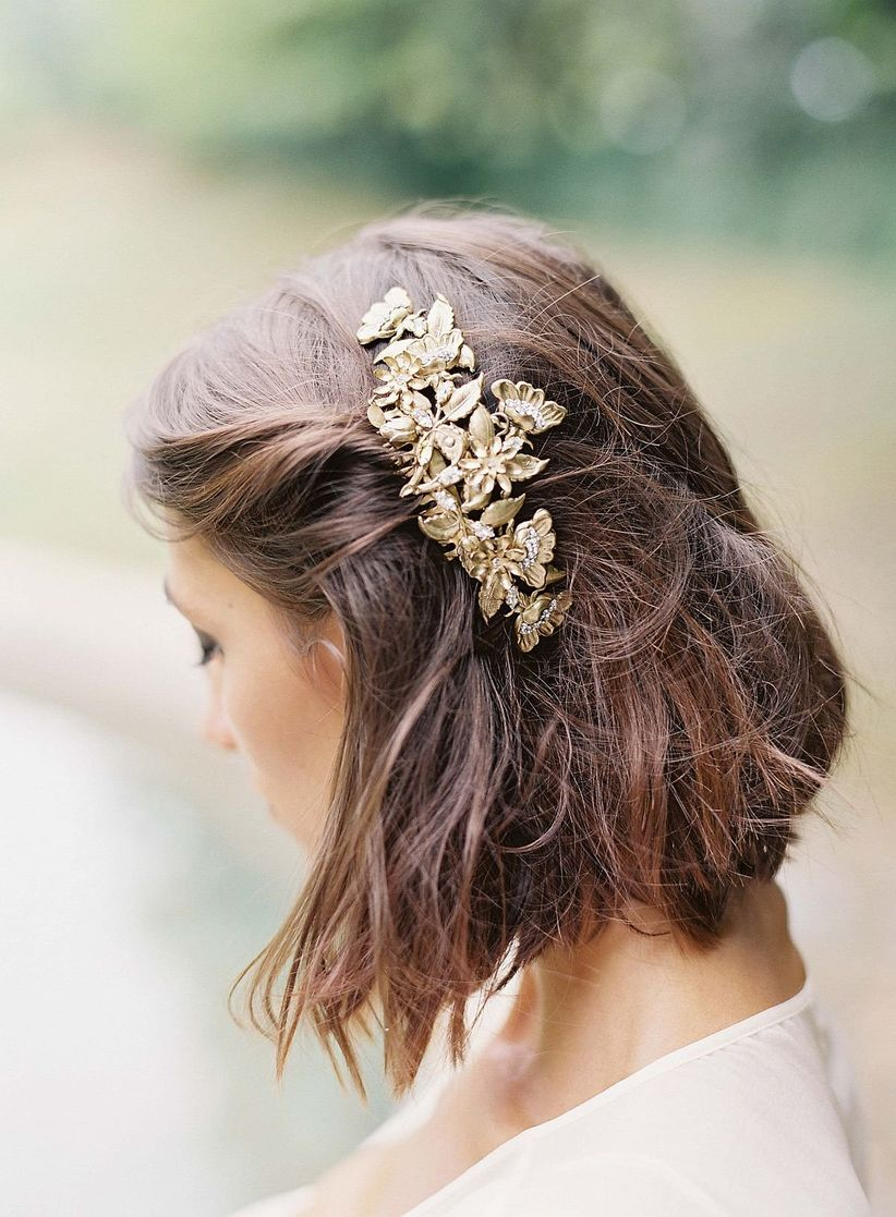 bride with pulled back hairstyle in gold barrette