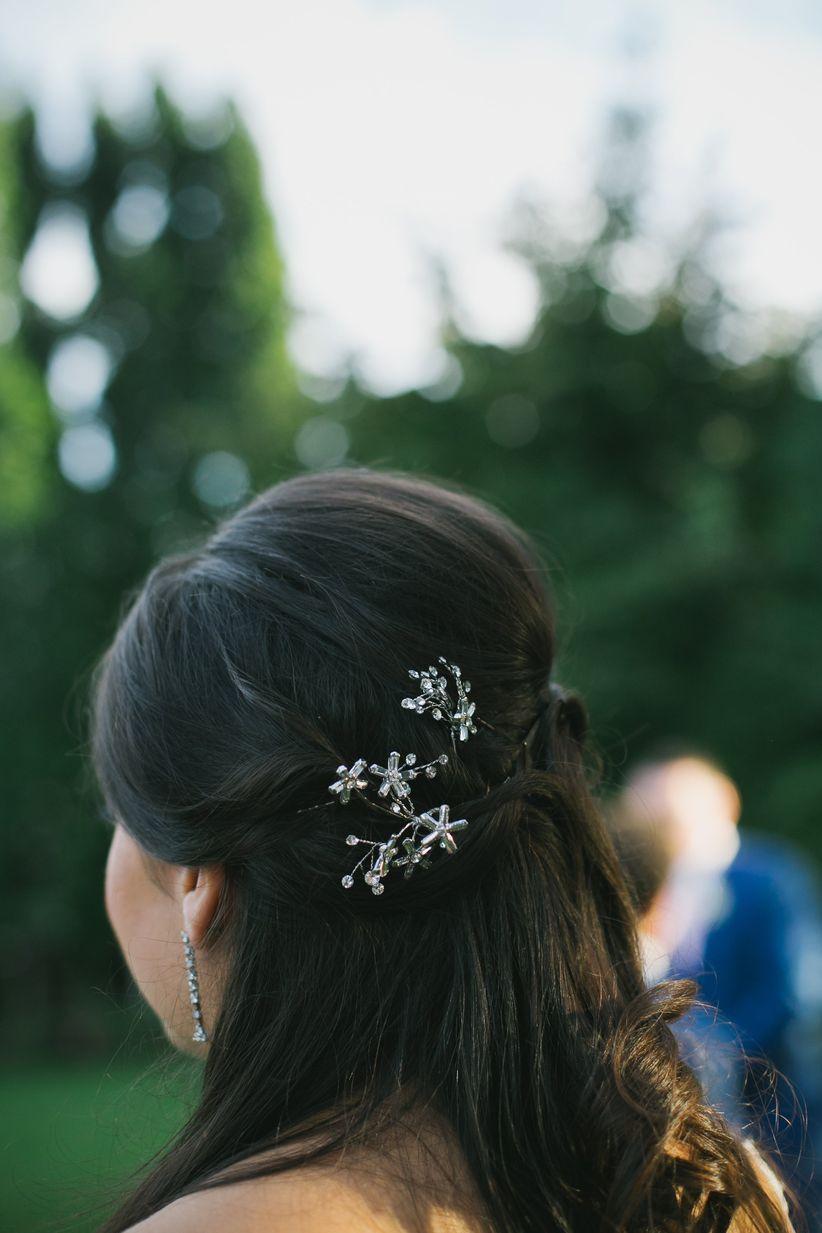 bridesmaid half up hairstyle floral hair clip