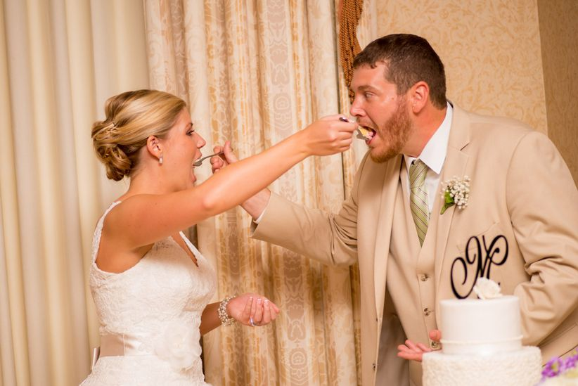 couple feeding cake