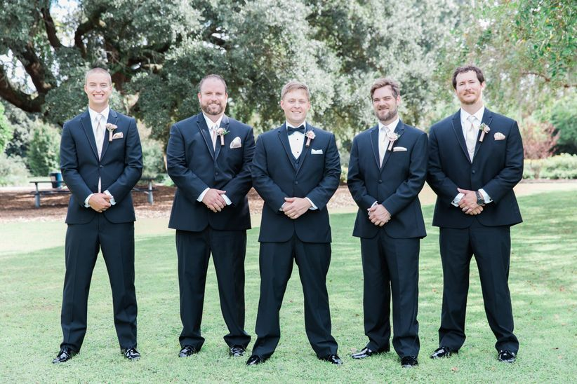outdoor formal portrait groomsmen black tuxedos