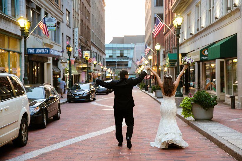 couple walking down hartford street