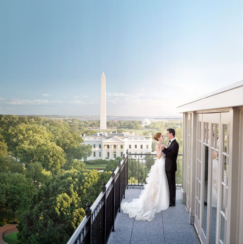 couple dances on the rooftop of The Hay-Adams hotel during their wedding. White House can be seen in the background.
