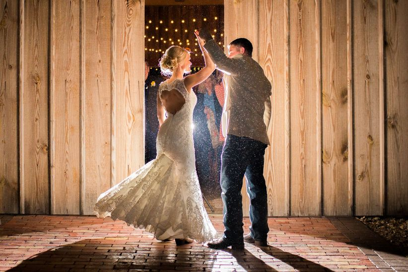 bride and groom dancing at night
