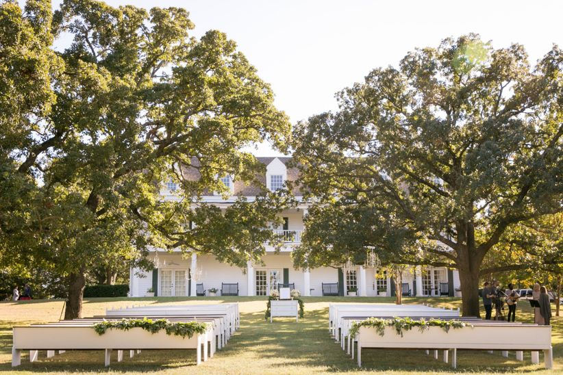 wedding ceremony outside historic home