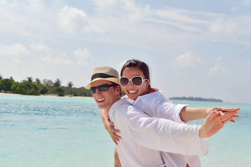 couple on beach honeymoon