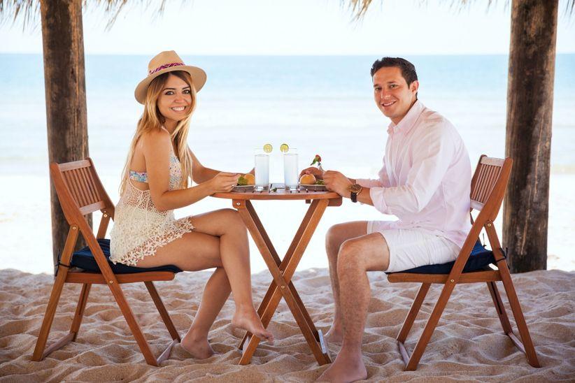 couple eating meal on honeymoon