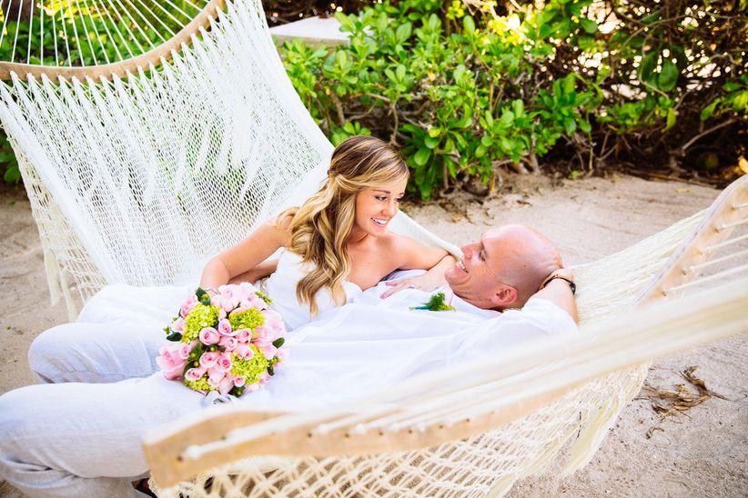 wedding couple relaxing on a hammock at a beach wedding