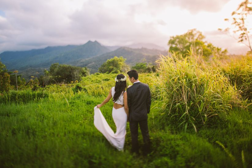 a couple walking hand in hand in a scenic tropical location