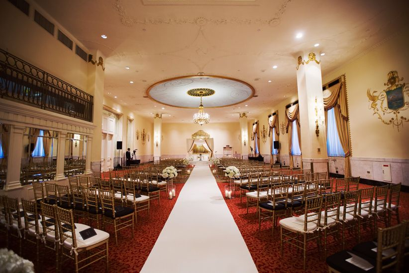 hotel wedding venue with unique ceiling and ceremony set up