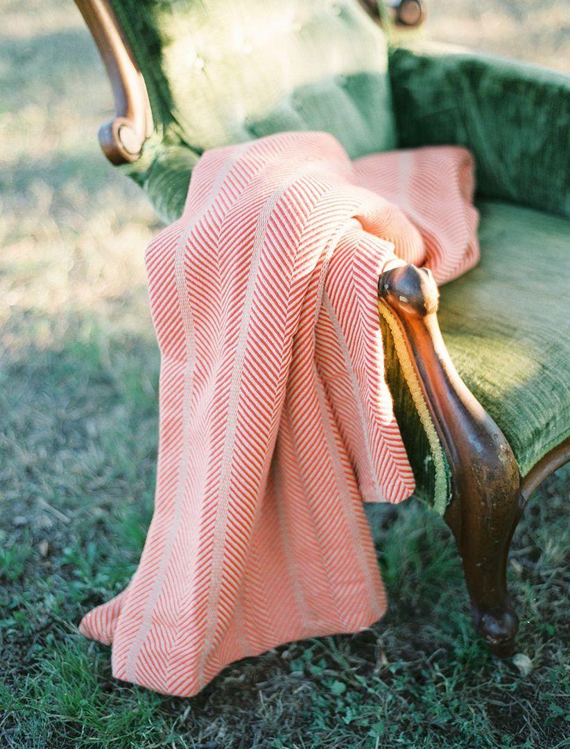 blanket on a velvet lounge chair