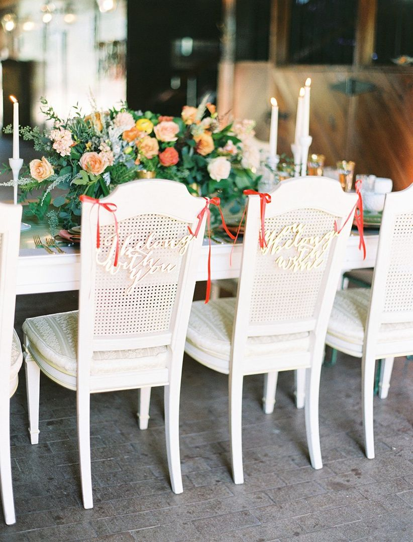 reception chairs decorated with signage