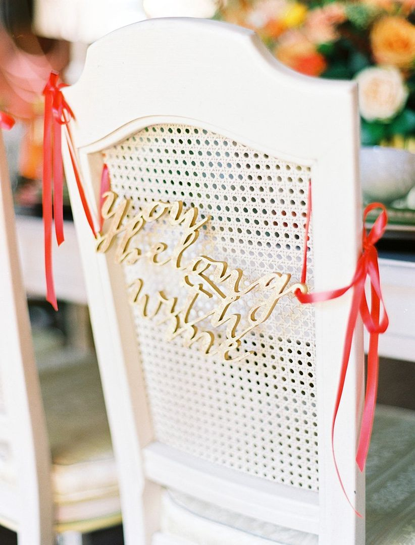 gold sign hanging on chair
