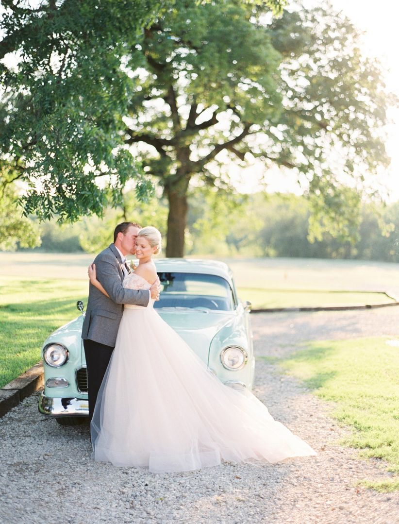 couple in front of vintage getaway car
