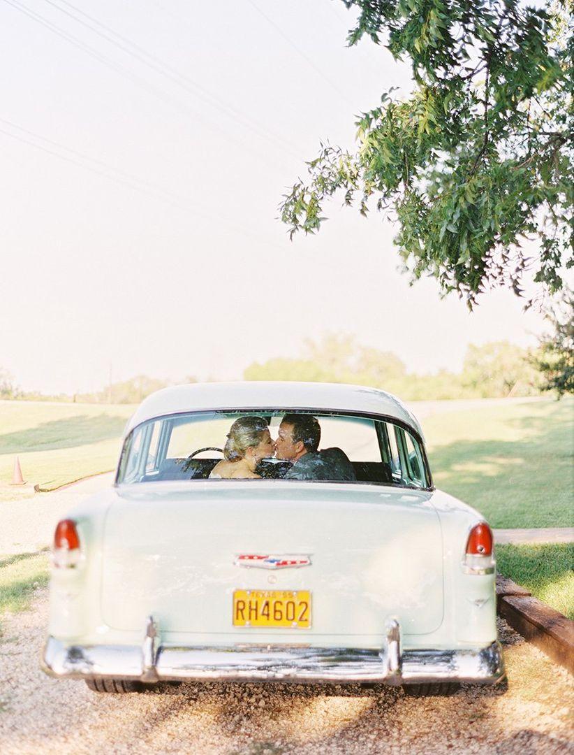 couple kissing in vintage getaway car