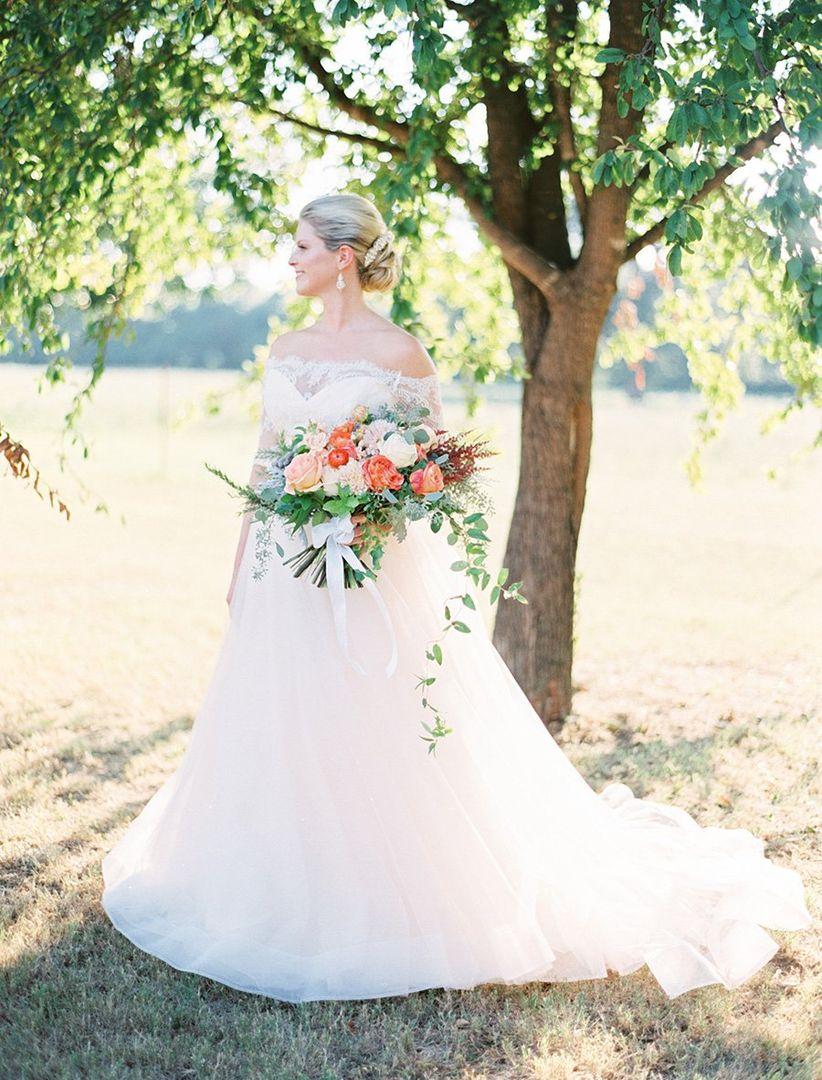 bride wearing a romantic tulle wedding dress