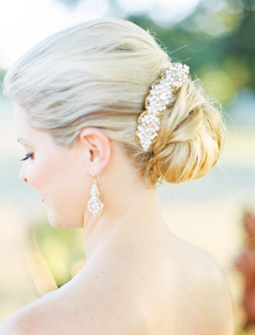 elegant chignon updo with hair acceesory