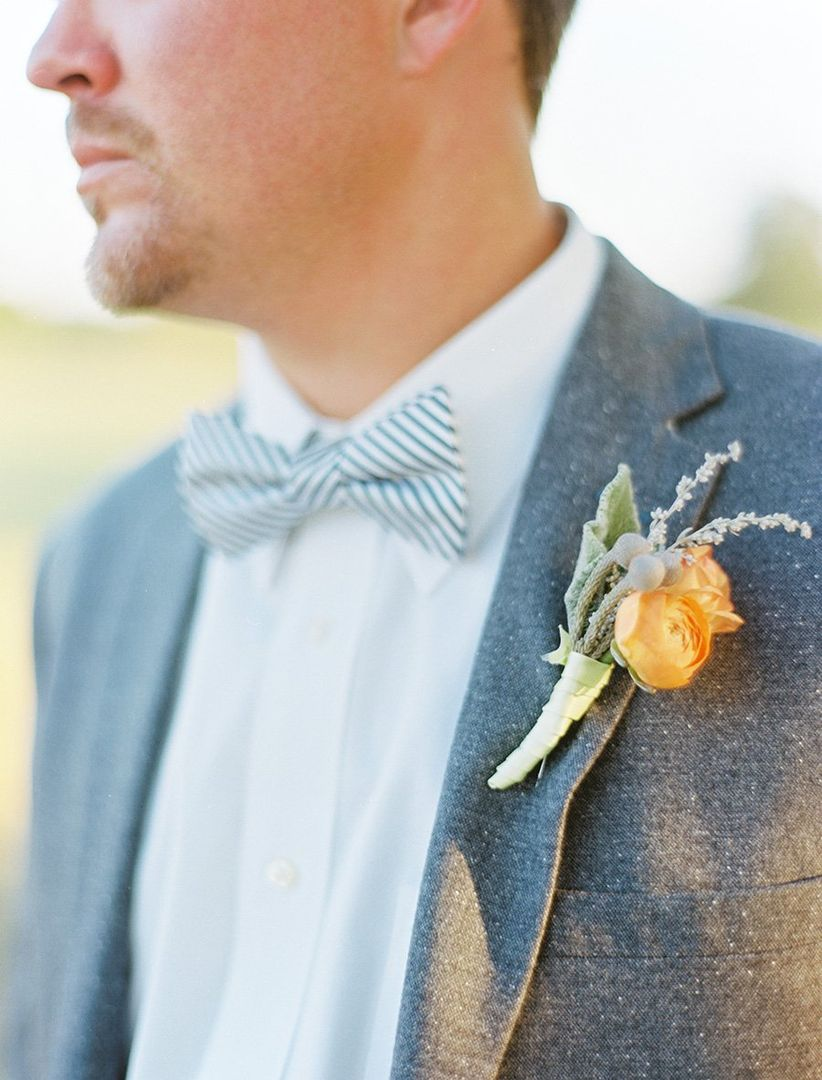 groom's boutonniere and bow tie