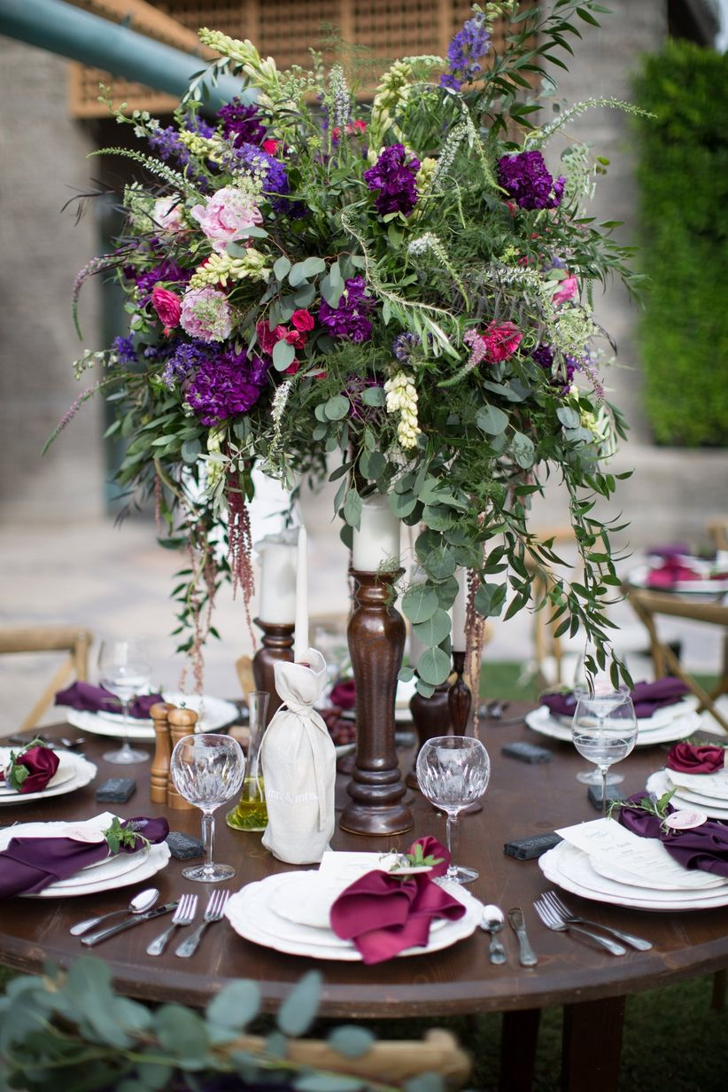purple and burgundy wedding centerpiece
