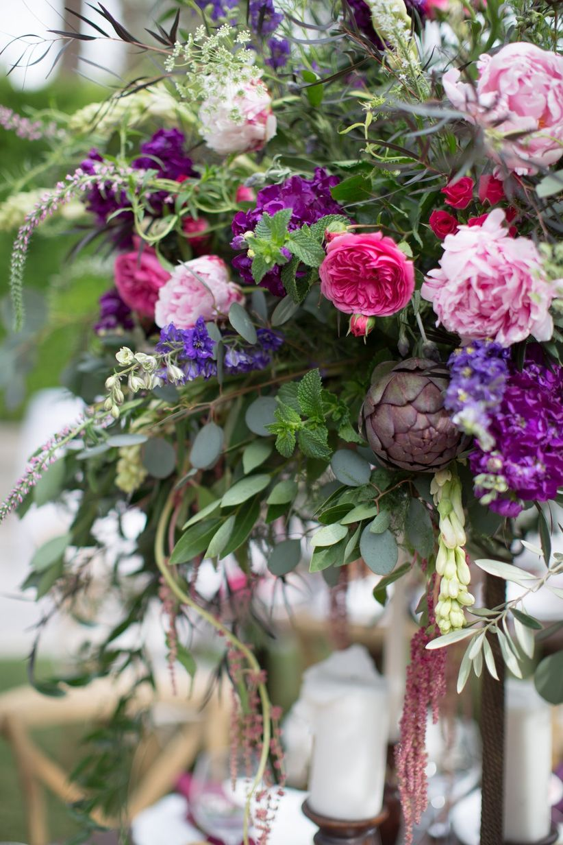 purple and pink wedding centerpiece with greenery