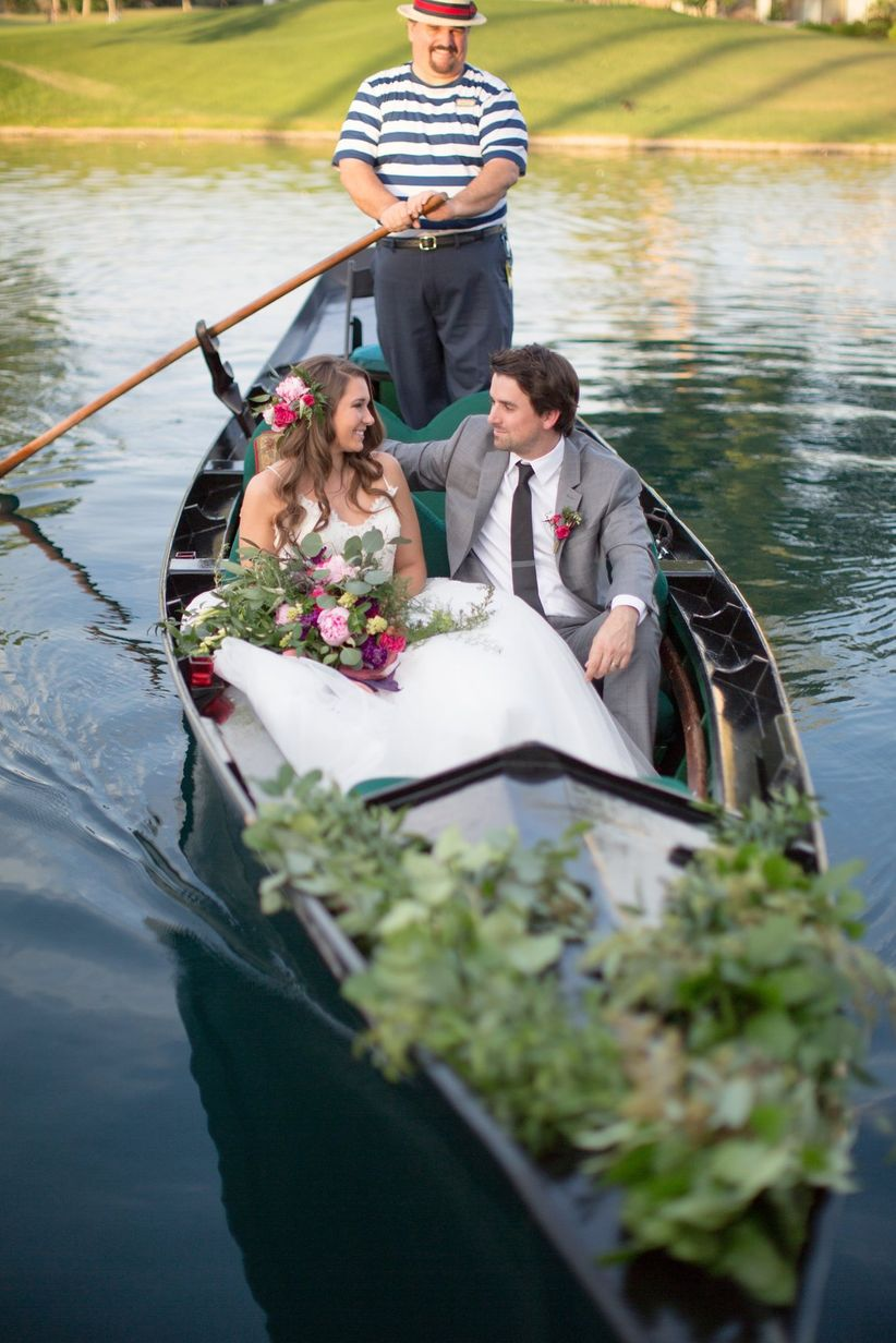 bride and groom in a gondola